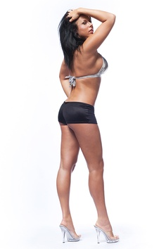 Young beautiful fitness model with long black hair.